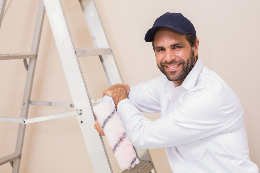professional painter smiling during work